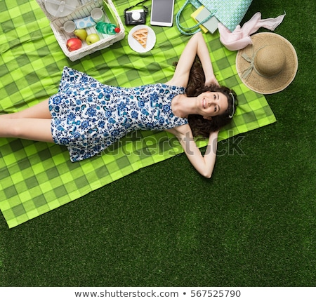 gülen · çift · oturma · çim · yaz · park - stok fotoğraf © deandrobot