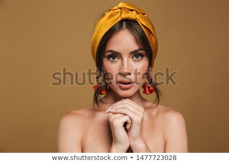 Close up of a pretty young topless woman isolated Stock photo © deandrobot