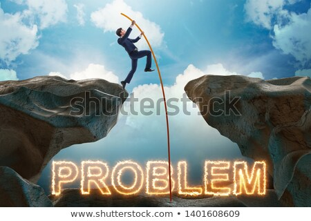 Businessman jumping over burning problems Stock photo © Elnur