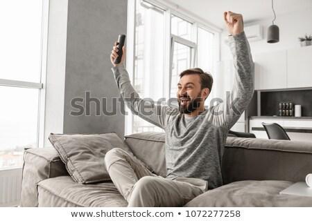 Portret podniecony młody człowiek kontroli Zdjęcia stock © deandrobot