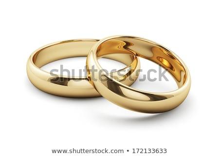 Kettő arany eljegyzés gyűrűk izolált fehér Stock fotó © MarySan