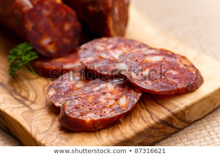 Spanish chorizo sausage with vegetables on a wooden board Stock photo © Melnyk