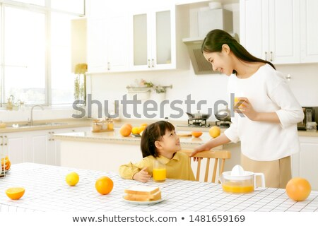 daughter drinking the juice from glass stock photo © andreypopov