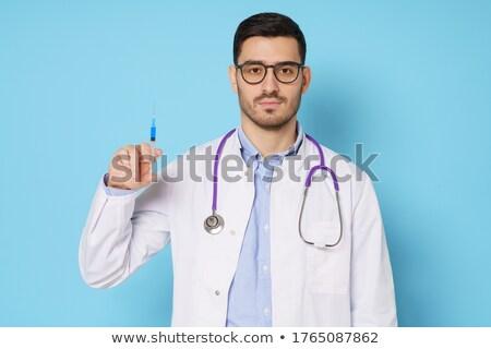 Młodych przystojny lekarza strzykawki odizolowany biały Zdjęcia stock © Elnur