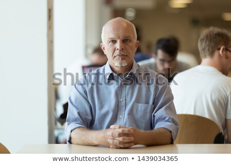 Serious senior man sitting alone in a cafeteria Stock photo © Giulio_Fornasar