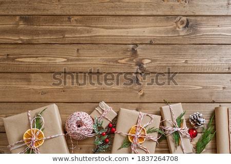 Ajándékok karácsony kinyitott ajándék fenyőfa hó Stock fotó © Wetzkaz