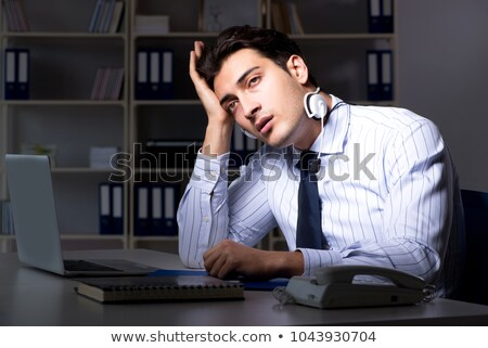Tired and exhausted helpdesk operator during night shift Stock photo © Elnur