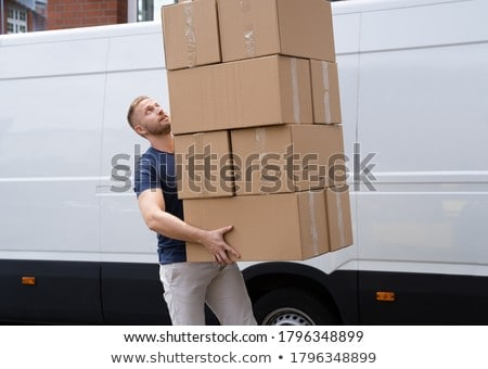 Movers Carrying Heavy Large Box Stack Stock photo © AndreyPopov