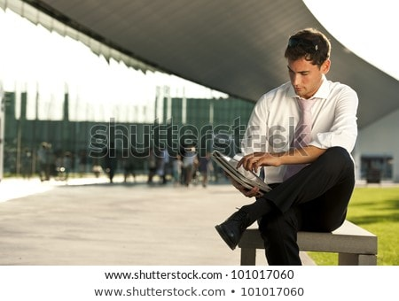Businessman sitting cross-legged using tablet Stock photo © Rugdal