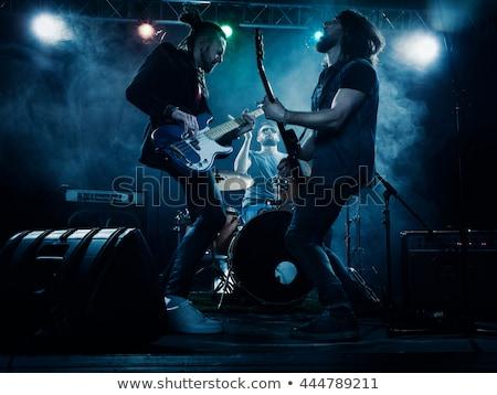 jovem · músico · guitarra · elétrica · dramático · iluminação · cabelo - foto stock © stokkete