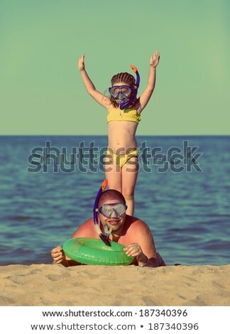 father and daughter in scuba mask   vintage retro style stock photo © mikko