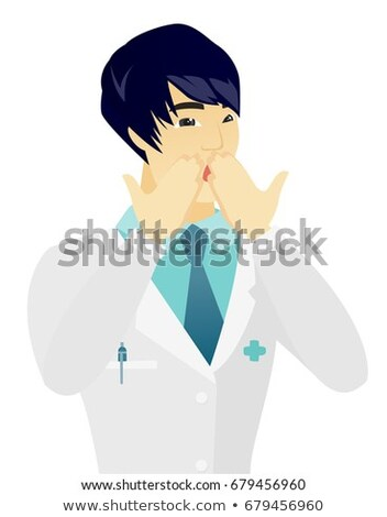 Shoked asian doctor covering his mouth. Stock photo © RAStudio