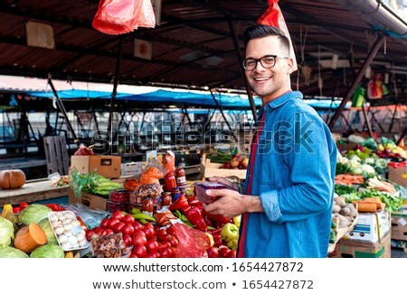 Portrait of man at outdoor market Stock photo © IS2