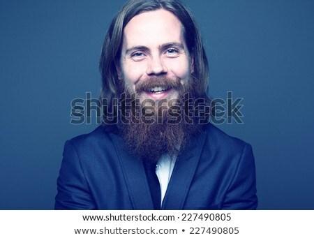 Ernstig mode man smoking vergadering zwarte Stockfoto © feedough