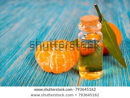 Tangerina Óleo fresco vidro comida médico Foto stock © tycoon