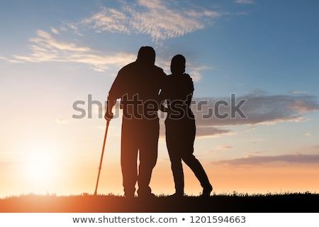 Silhouette Of Woman Assisting Her Disabled Father Stock photo © AndreyPopov