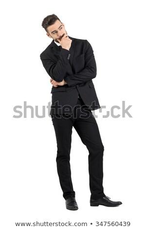 Jonge nadenkend elegante man smoking permanente Stockfoto © feedough