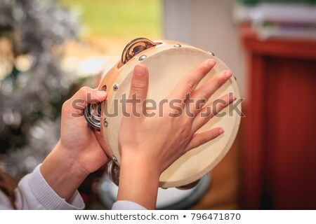 Christmas child playing the tambourine on a white background Stock photo © Imaagio
