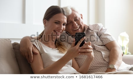 image of positive man and woman using smartphones together isol stock photo © deandrobot