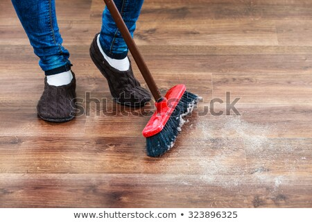 woman with sweeping broom brush cleaning floor Stock photo © dolgachov