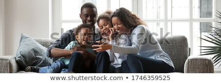 man with smartphone having video call at new home Stock photo © dolgachov