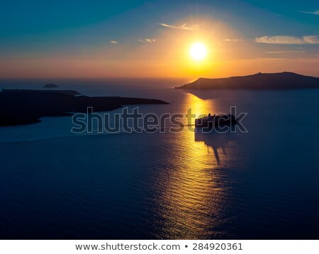 Cruise ship silhouette in Aegean sea on sunset Stock photo © dmitry_rukhlenko