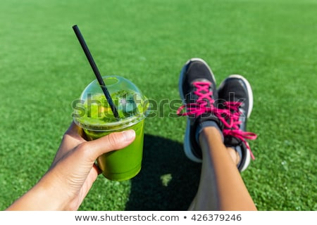 Green smoothie breakfast detox diet food cleanse juice drink. Woman eating healthy for weight loss,  Stock photo © Maridav