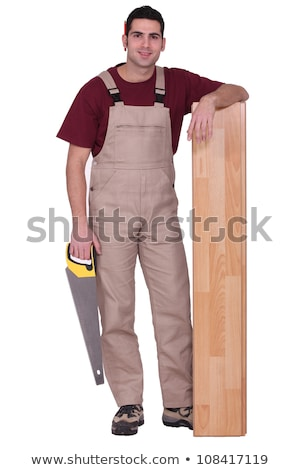 Stock photo: Man stood with laminate flooring and saw