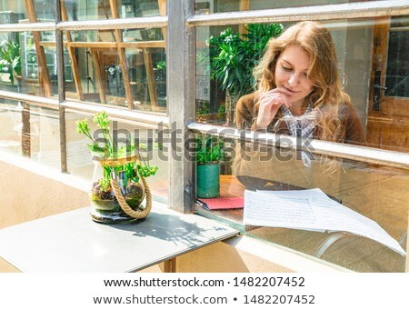 Pensive woman resting on a drum stock photo © photography33