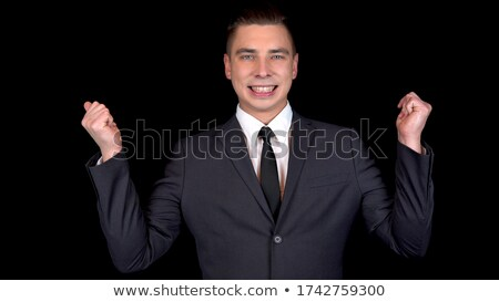 handsome man in tuxedo is snapping fingers and looks away Stock photo © feedough