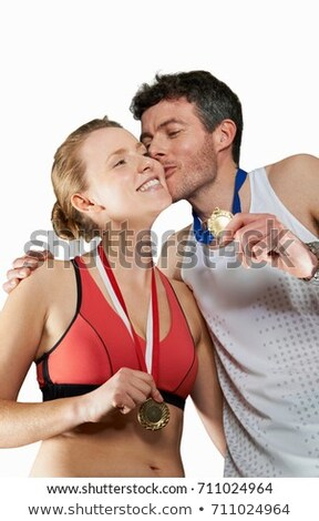 Couple in running gear wearing medals Stock photo © IS2
