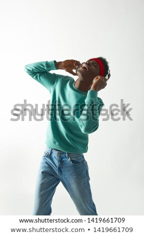 happy young man in headphones and red hoodie Stock photo © dolgachov