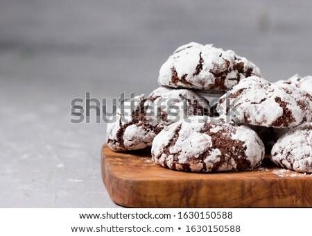 Fresh baked chocolate cookies in sugar powder Stock photo © dariazu