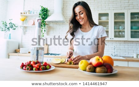 pregnant woman with blender making smoothie drink Stock photo © dolgachov