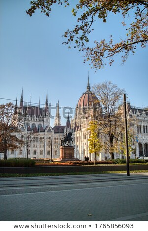 Rakoczi Ferenc equestrian statue on the background of Hungarian paliament building. Stock photo © artjazz