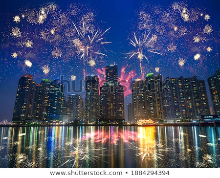 Busan Marina city skyscrapers illluminated in night Stock photo © dmitry_rukhlenko