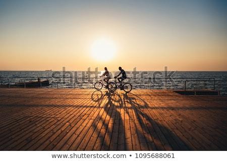 Pessoas ciclismo praia céu homem feliz Foto stock © photography33