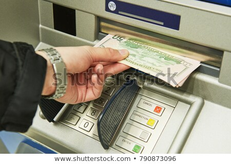 hand inserting banknote into cash dispense Stock photo © Mikko