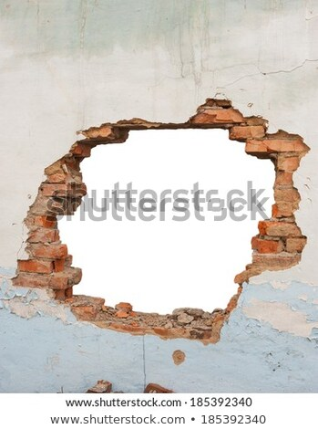 Hole in a brick wall Stock photo © cherezoff