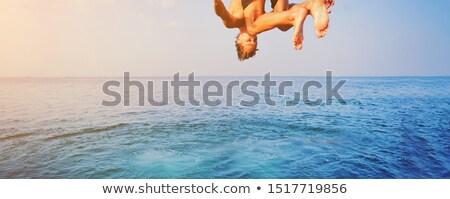 Fiú ugrik levegő tengerpart dél víz Stock fotó © meinzahn