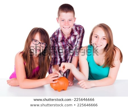 Two Teenage Girls Putting Money Into Piggy Bank Stock photo © monkey_business