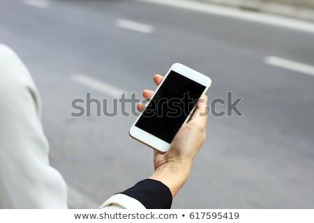 Uygulaması cep telefonu yukarı ekran görmek Stok fotoğraf © stevanovicigor