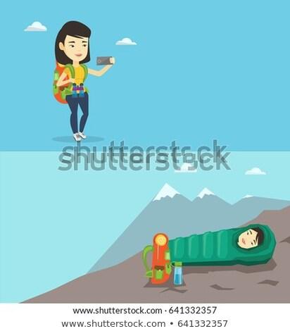 Tourist Taking Photo of Mountain Landscape Vector Stock photo © robuart