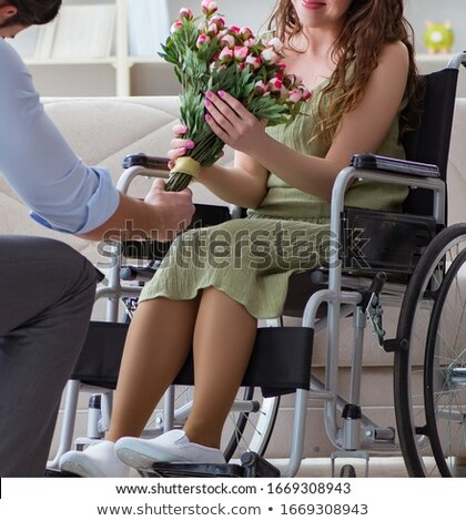 The man making marriage proposal to disabled woman on wheelchair Stock photo © Elnur