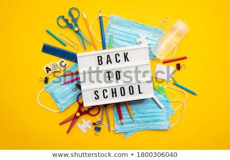хирургические маски текста Снова в школу синий написанный желтый Сток-фото © nito