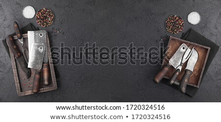 Vintage hatchets for meat in wooden box with salt and pepper on wooden table background with linen t Stock photo © DenisMArt