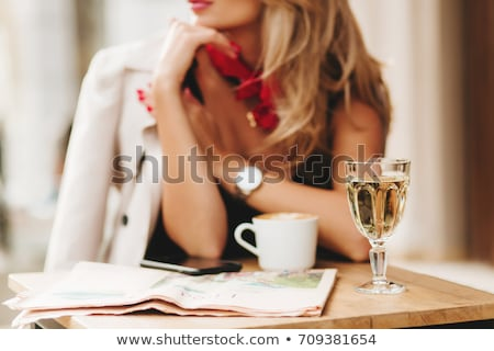 Elegant woman with a glass of champagne. Stock photo © gromovataya