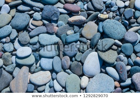 Blue tinted beach stones natural abstract. Stock photo © latent