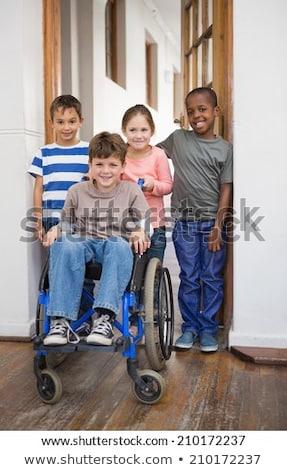 Inválido amigos sala de aula escola primária menina escolas Foto stock © wavebreak_media