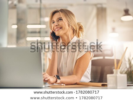 smiling businesswoman on the phone stock photo © wavebreak_media